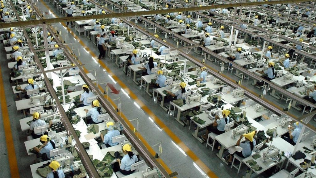 Chinese workers in production factory assembling export goods that U.S. President Trump considers targets in his trade war rhetoric.