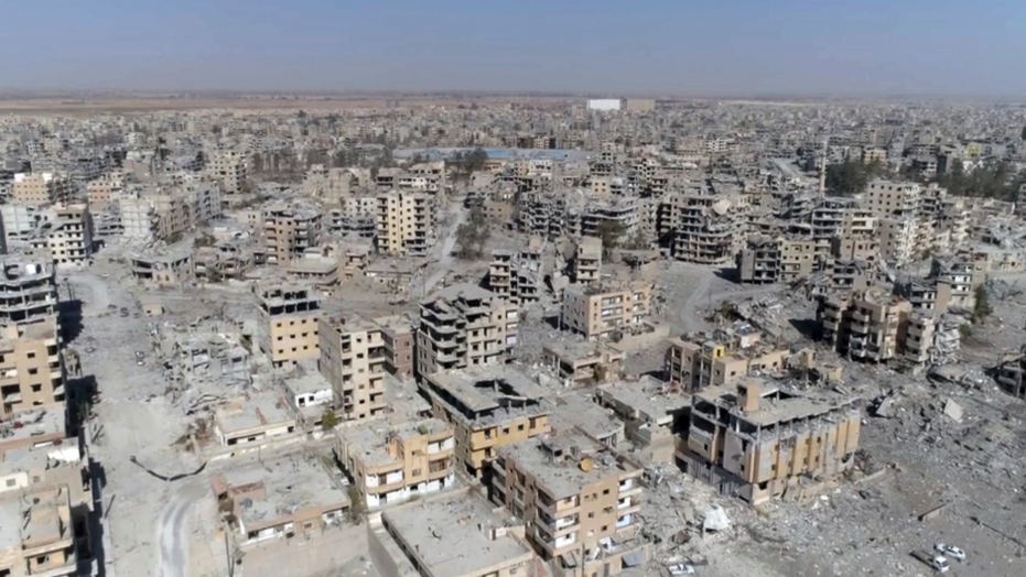 photo image of bombed out apartments and buildings in the suburbs of Damascus.