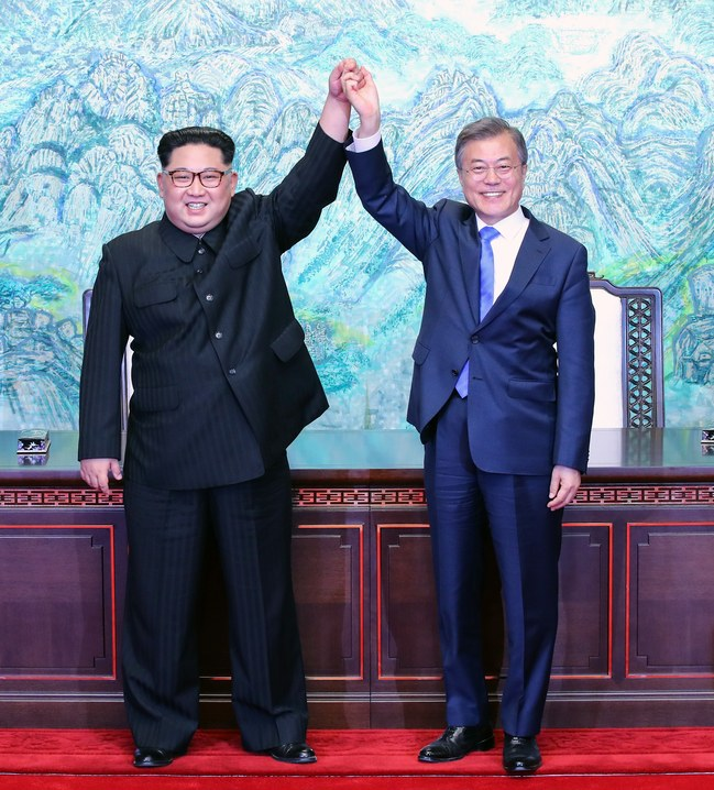 photo from Korea reporter's pool of North Korean dictator Kim Jong-un and South Korean President Moon Jae-in posing in acclimation of their recent summit meeting