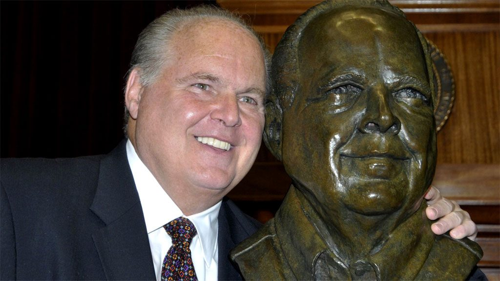 photo of Rush Limbaugh taking selfie with a bronze likeness of himself