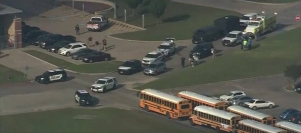 Sky cam view of Santa Fe High School with law enforcement and first responder vehicles staging response to Friday's mass shooting on campus