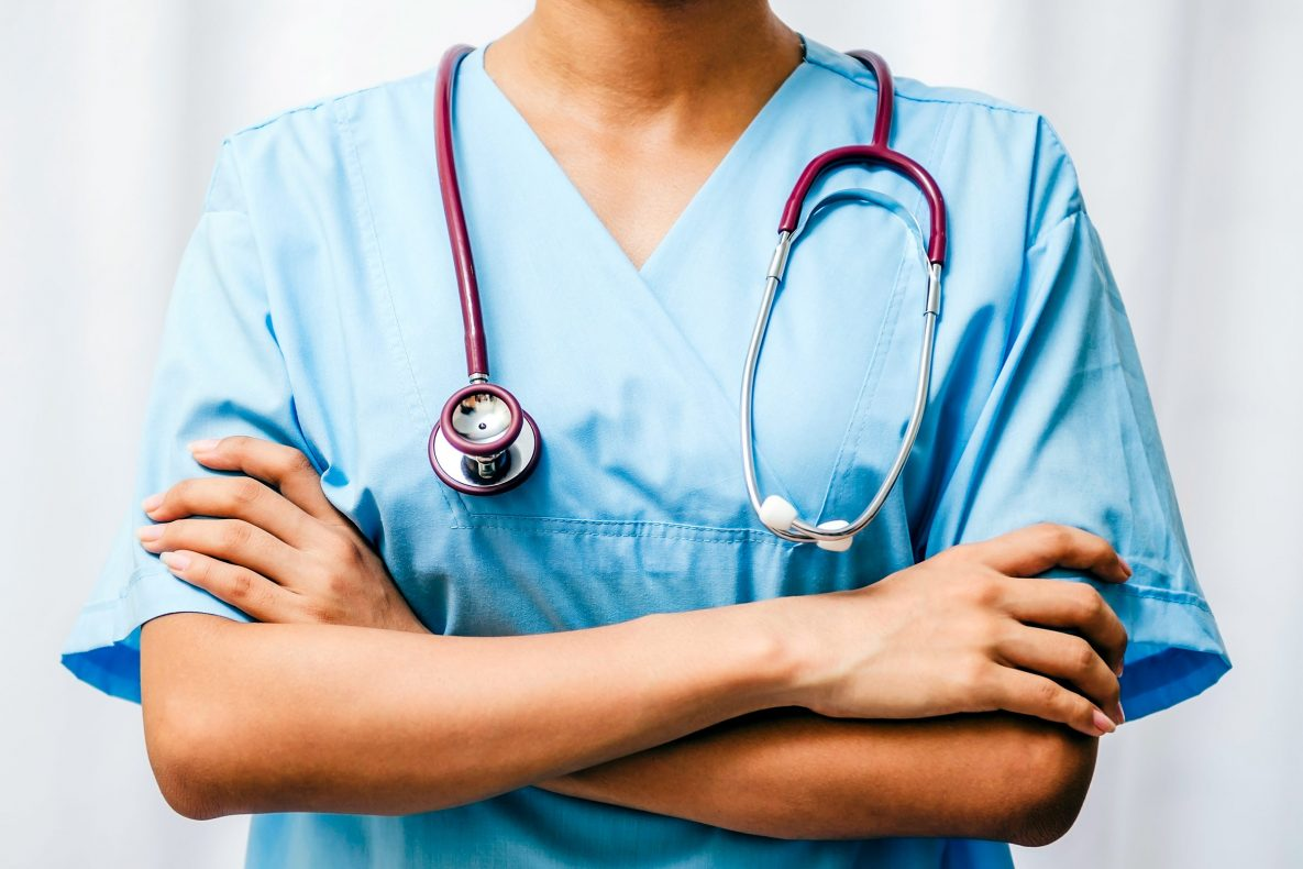 image of physician in hospital scrubs and with stethoscope