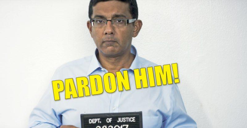 Picture of Mr. D'Souza holding prisoner number.