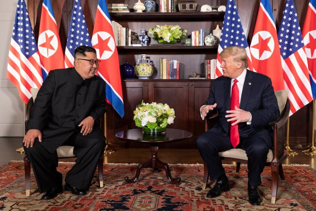 President Donald J. Trump and the North Korean leader Kim Jong Un sit together.