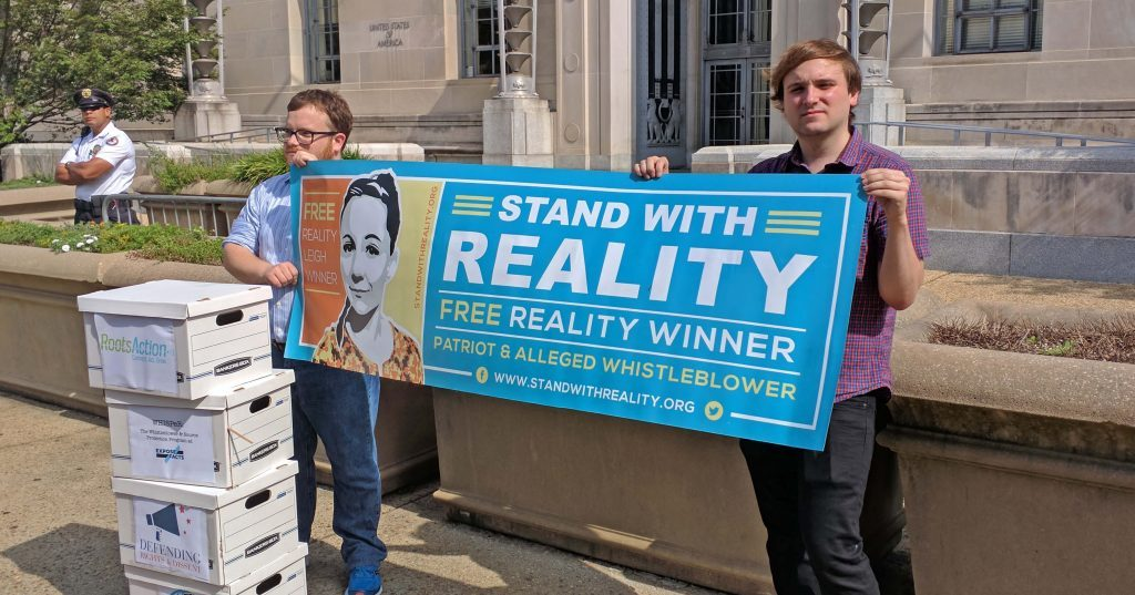 demonstrators protesting against the prosecution of Reality Winner, government whistleblower that revealed Russian tampering with American election equipment in November 2016 presidential election.