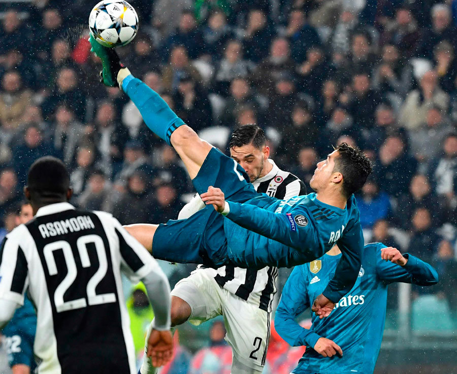 Ronaldo bike kicks a ball.