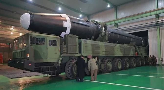 a photo of North Korea's longest range Inter-Continental Ballistic Missile, the Hwasong-15, capable of striking targets as far from North Korea as the East Coast of the United States