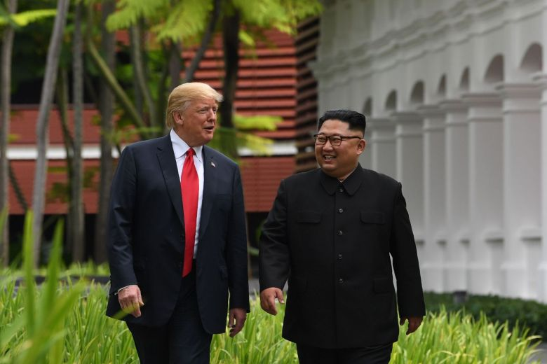 photo of U.S. President Donald Trump and North Korean leader Kim Jong Un walking together at their summit meeting in June in Singapore