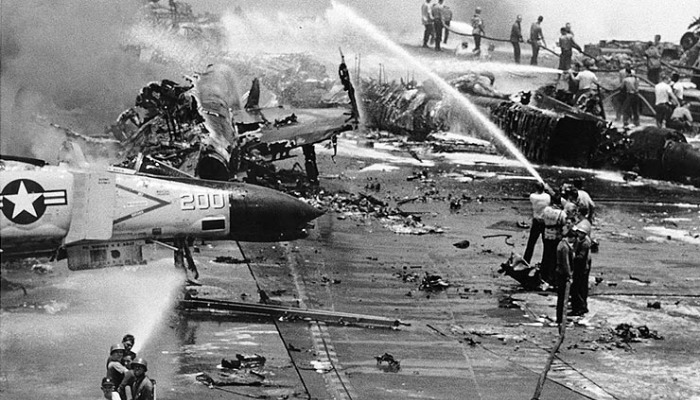Black and White photo image of the crews fighting the various fires on the deck of the U.S.S. Forrestal in July 1967