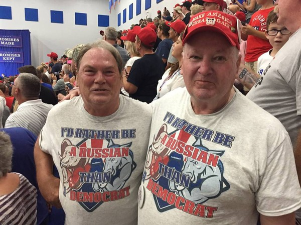"two Trump rally goers wearing T-shirts bearing a slogan, ""I'd rather be Russian than Democrat"""