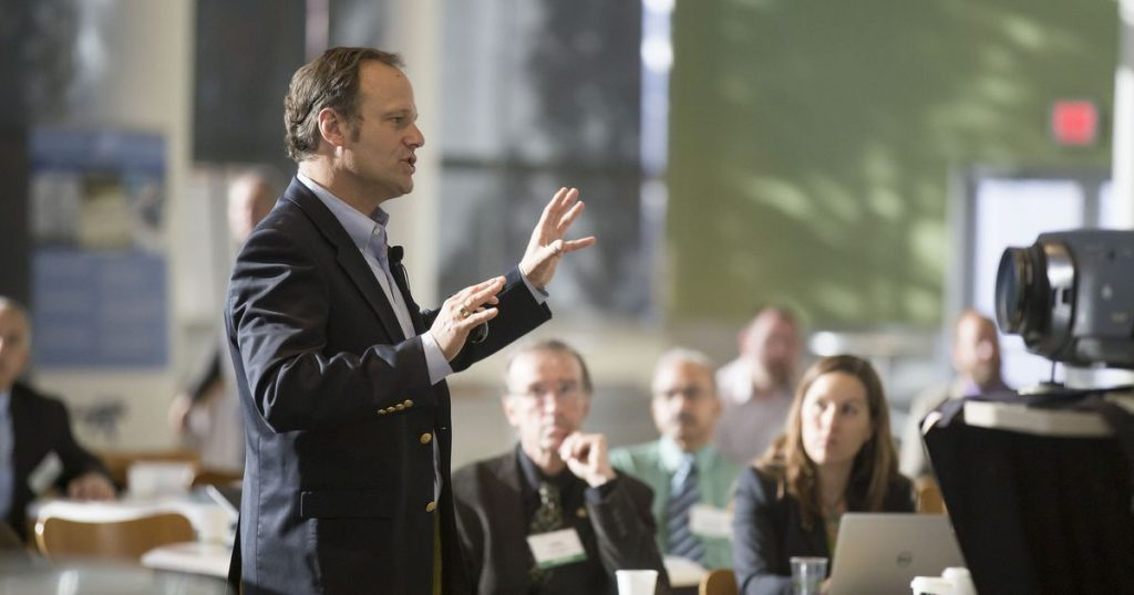 image of man speaking in a conference
