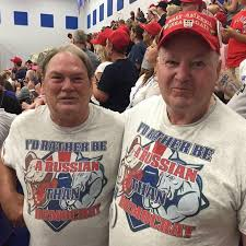 "Men wearing T-shirts that say ""I'd Rather Be Russian Than Democrat."""