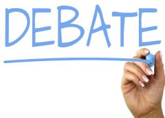 "graphic with hand and marker writing the word ""debate"""