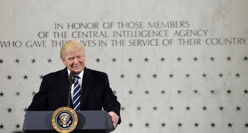 Mr. Trump in front of the memorial of fallen CIA agents.