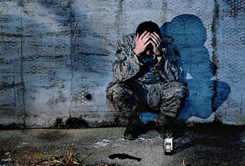 photo of active duty serviceman experiencing emotional distress