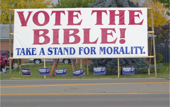 "photo of large banner proclaiming, ""Vote The Bible (Take A Stand For Morality)"""