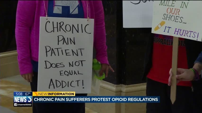 photo of protest against opioid crackdown that has deprived chronic pain sufferers the pain medications they rely on