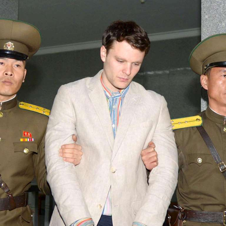 Otto Warmbier being led away from Kangaroo Court proceeding after being convicted on the charge of having stolen a propaganda poster.