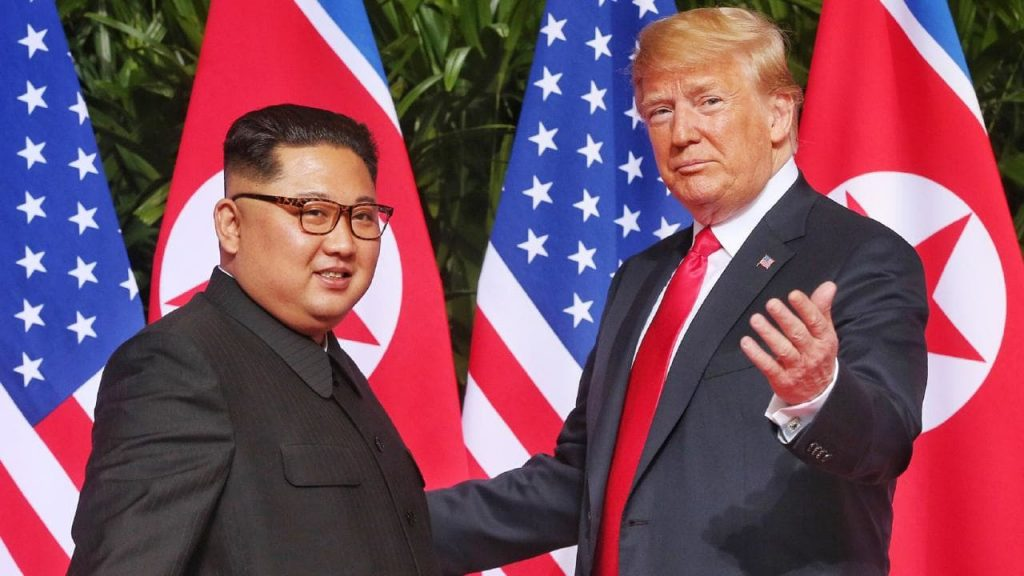 photo of American President Donald Trump gratuitously shaking hands with brutal and oppressive North Korean autocrat, Kim Jong-un.