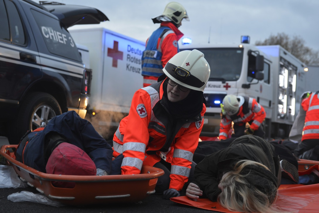 photo of an Emergency Medical team providing treatment to an accident victim