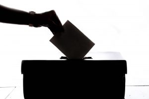 A ballot being dropped into a ballot box