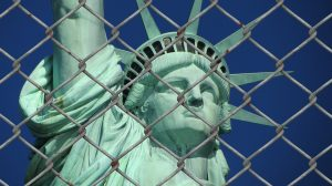 Statue of Liberty behind chain fence