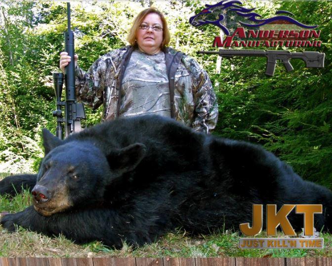 Woman killing a bear.