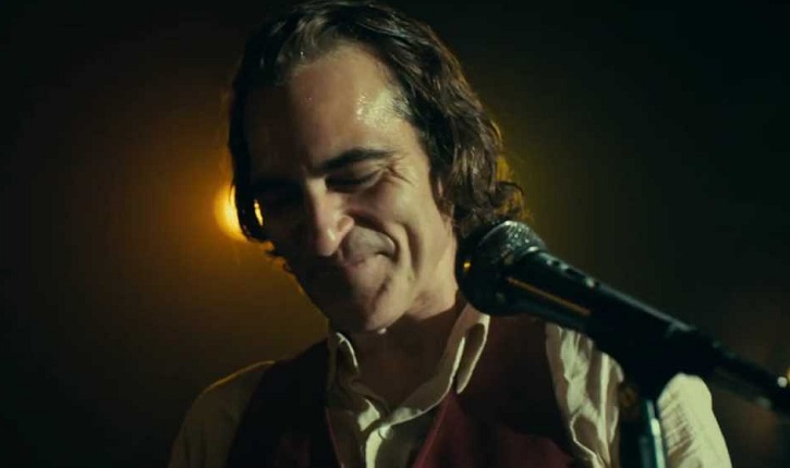 "Joaquin Phoenix as Arthur Fleck, in Todd Phillips' film ""Joker"", in a scene where Fleck attempts to audition as a stand up comic."
