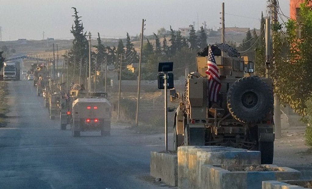 Image of American forces convoy retreating from Syria.