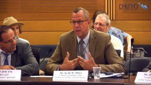 photo of author and former State Department official, Keith W. Mines at a meeting in Israel