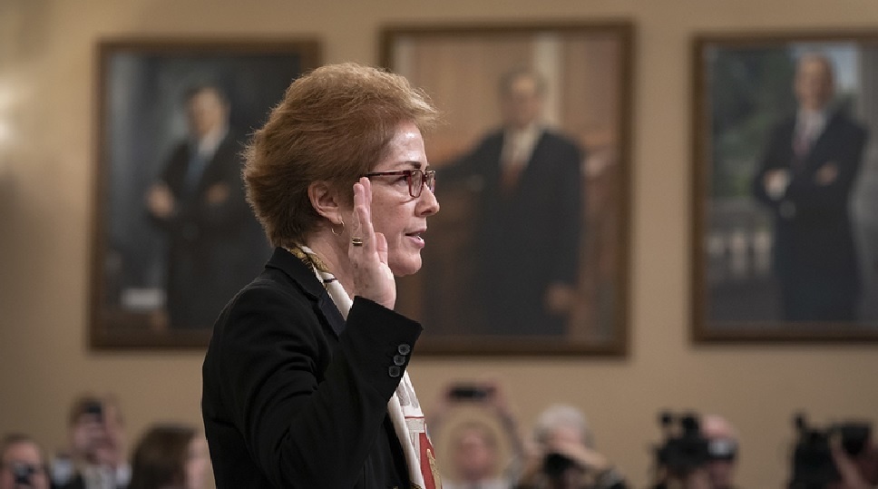 Former Ambassador to Ukraine, Marie Yovanovitch raising right hand to swear to provide, under oath, truthful testimony in the Impeachment Inquiry hearings open session in the U.S. Capitol.