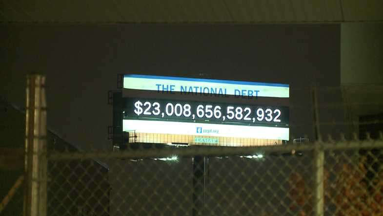National Debt clock on a digitized real time updating billboard in Milwaukee, Wisconsin by the Peterson Foundation.