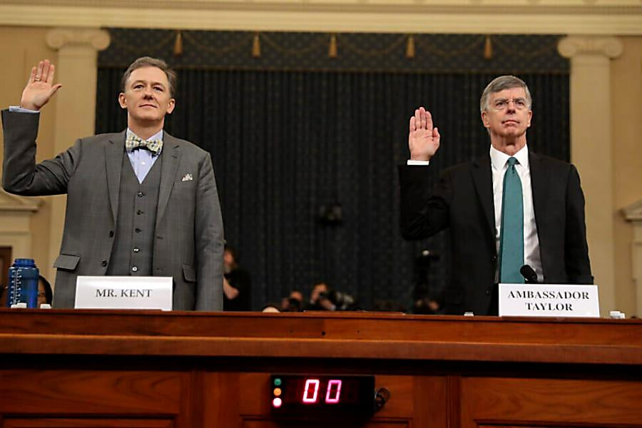 photo of Ambassador Taylor and Deputy Assistant Secretary George Kent during the swearing in of their testimony to the Impeachment Inquiry hearings