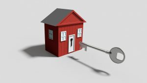drawing of a tiny house with a large key