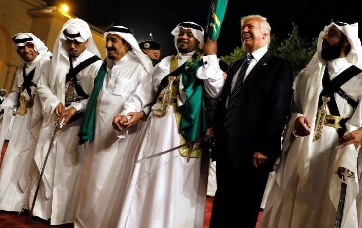 U.S. President Donald Trump joining members of the Saudi monarchy in a sword dance during a visit to the Kingdom