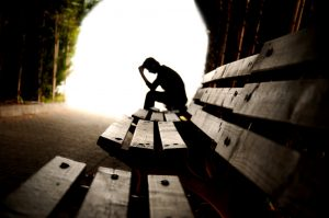 Man sitting on a bench.