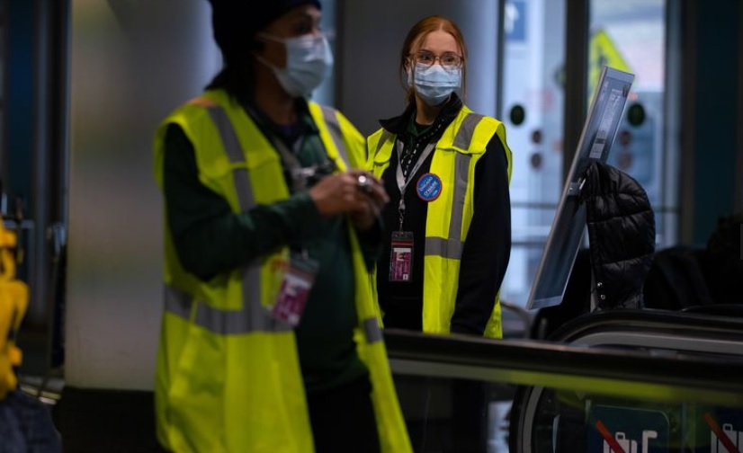 infectious disease personnel at Chicago's O'Hare International airport wearing virus prevention masks to protect against the Novel Coronavirus.