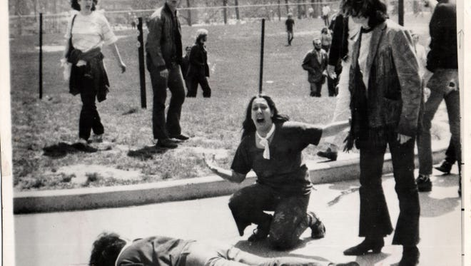 In this Pulitzer Prize winning photo by John Filo, Mary Ann Vecchio kneels over a student, 20 year old Jeffrey Miller, after Miller was shot in the head by an Ohio National Guardsman at Kent State University in 1970.