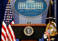 photo of the dais in the White House press briefing room with the Presidential Seal