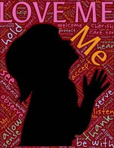 "child's silhouette with words sych as ""love me"" ""Care"" ""hold"" all around it"