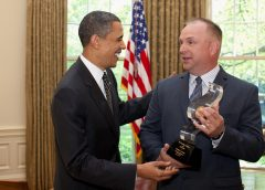 former President Barack Obama and country music superstar Garth Brooks greeting each other at the White House
