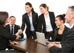 stock image of a group of business associates and clients engaging around a conference table - representing Stakeholder Engagement