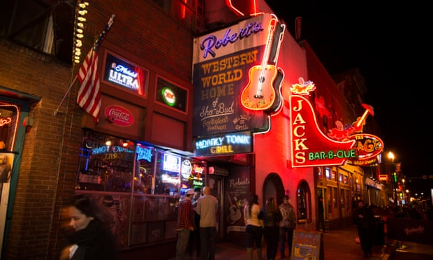 photo of the historic section of Downtown Nashville, Tennessee with neon signs and colorful retro store frontage.