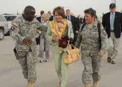 SATHER AIR BASE, Iraq -- Command Sgt. Maj. Marvin Hill, command sergeant major, Multi-National Force - Iraq (left), and Chief Master Sgt. Kathryn Godfrey, 447th Air Expeditionary Group superintendent, walk with Speaker of the House, Nancy Pelosi, on her way to visit with Airmen and Soldiers here May 17. Ms. Pelosi and seven other members of the U.S. House of Representatives visited Sather AB, adjacent to Baghdad International Airport. (U.S. Air Force photo/Tech. Sgt. Amanda Callahan)
