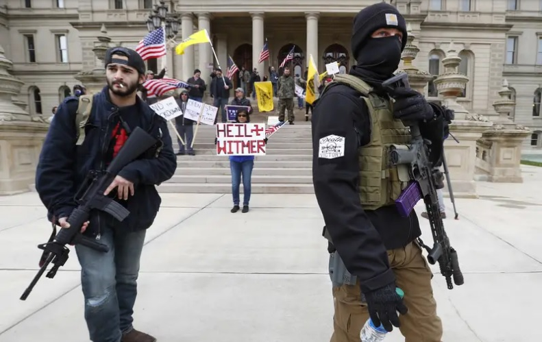 "photo of armed protesters at ""Operation Gridlock"" event at the Michigan State Capitol."