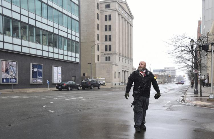 "photo of Phil Robinson, the leader of the Michigan Militia who participated in the anti-government protest in Lansing, Michigan, called ""Operation Gridlock"""