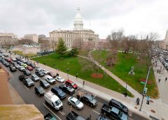 """overhead view of the parade of vehicles intended to block streets in the Lansing, Michigan Capitol district, during government protest dubbed, """"Operation Gridlock"""""""