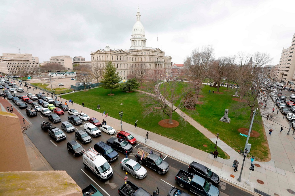 "overhead view of the parade of vehicles intended to block streets in the Lansing, Michigan Capitol district, during government protest dubbed, ""Operation Gridlock"""