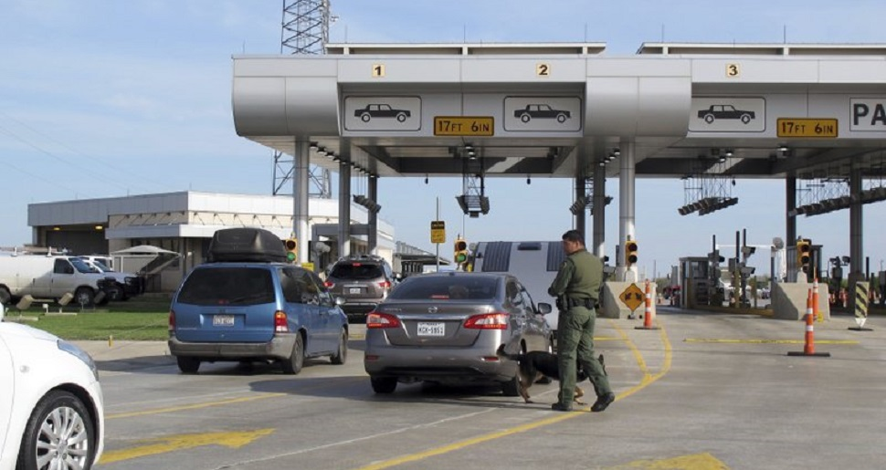 photo of Border Patrol checkpoint with cars lined up waiting for clearance or inspection