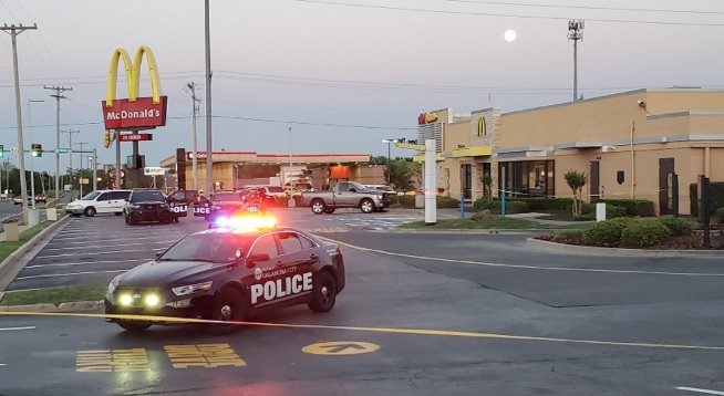 photo of scene in Oklahoma City, where police responded to a shooting incident at a Mc Donald's restaurant at which an angry customer denied service in the dining room because of coronavirus restrictions, shot 4 employees.